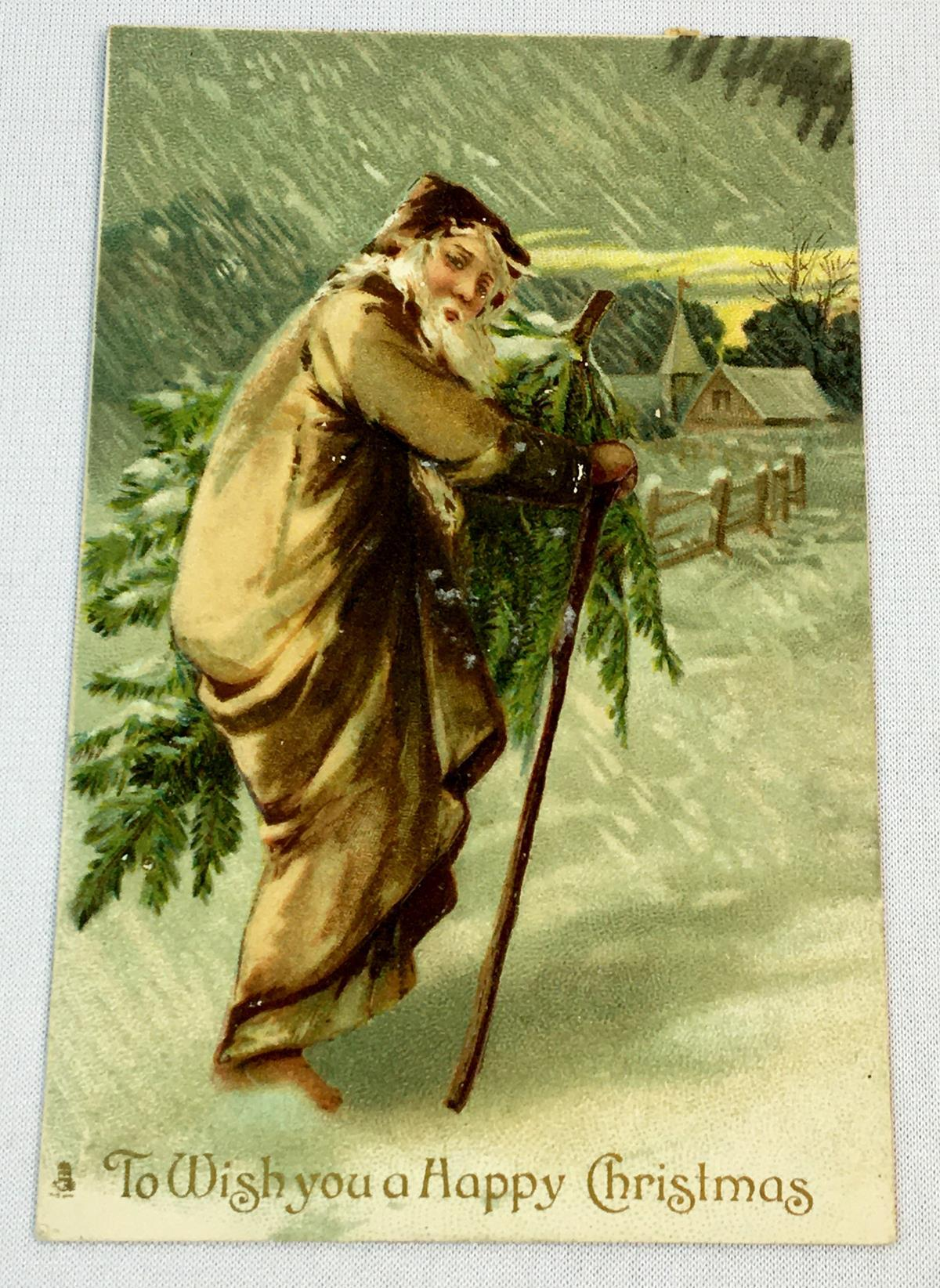 Antique 1907 Santa Claus In Brown Suit Carrying a Christmas Tree Embossed Tuck's Postcard