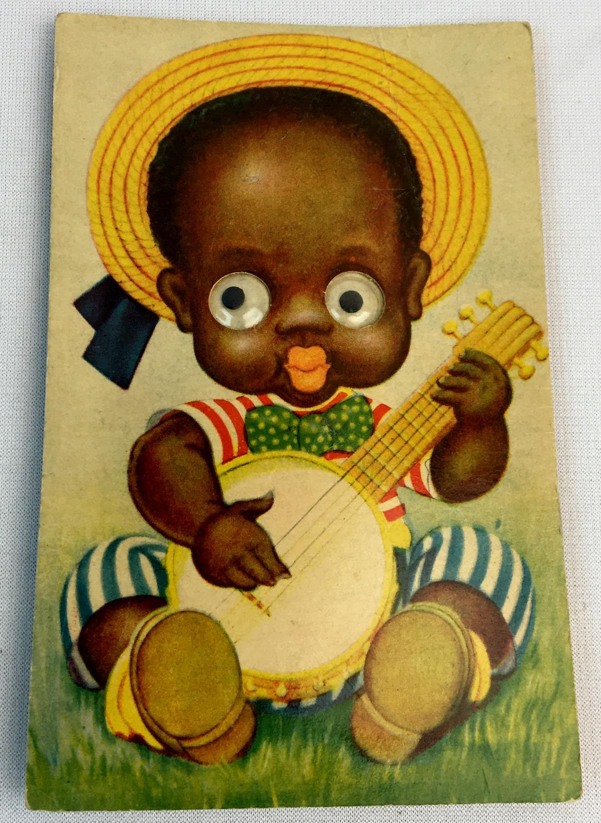 Antique c. 1910 Black Americana Patriotic Baby Playing The Banjo Squeaker Post Card w/ Googly Eyes
