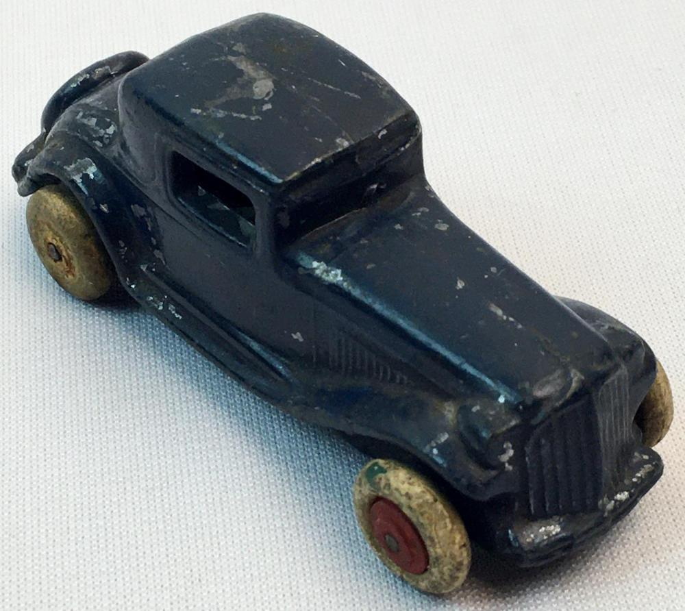 Antique 1930's Slush Mold Blue 2 Door Sedan w/ White Rubber Tires & Spare