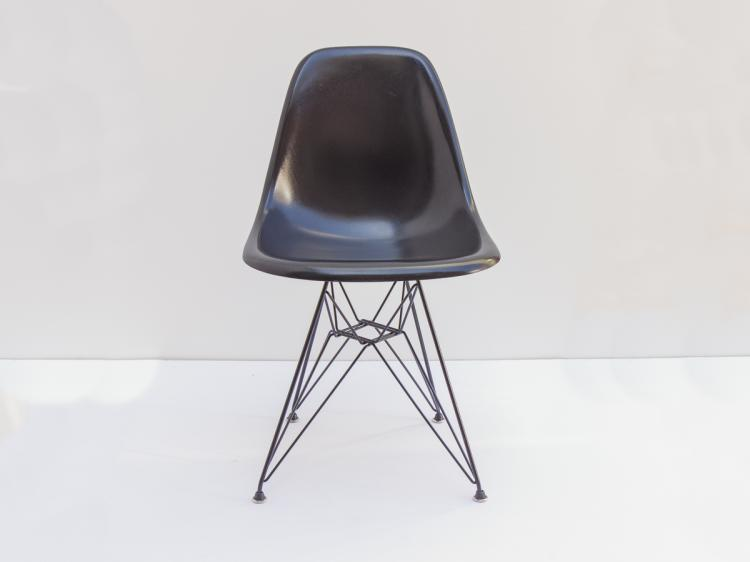 black eames shell chairs on eiffel bases