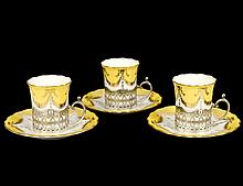 SET OF THREE COALPORT PORCELAIN STERLING SILVER CUPS AND SAUCERS