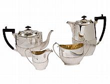 GEORGE IV FOUR PIECE STERLING SILVER TEA SERVICE