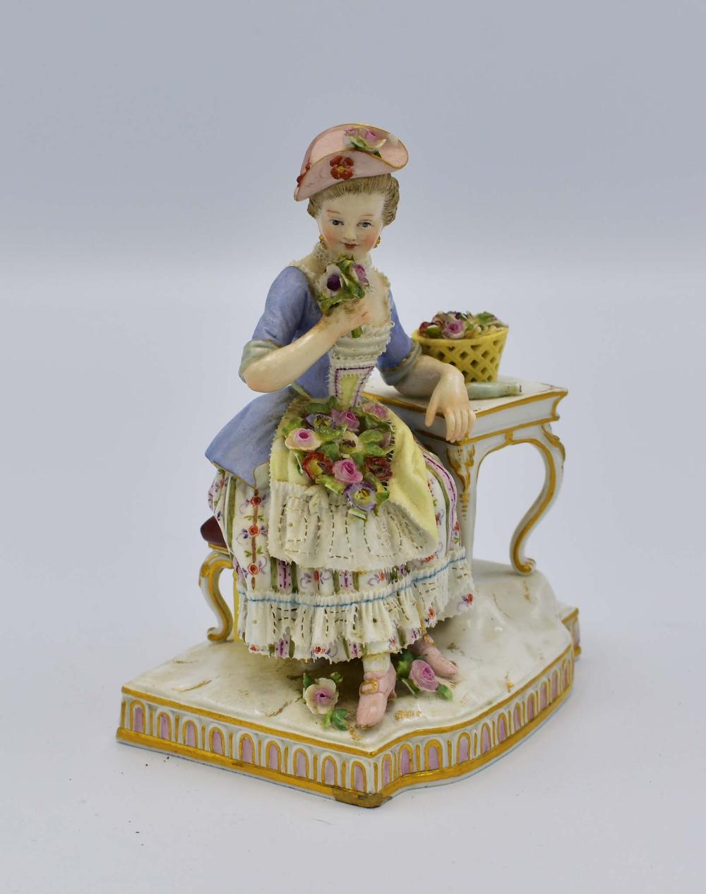 MEISSEN FIGURE OF A MAIDEN WITH FLOWERS