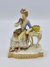 Lot 8: MEISSEN FIGURE OF A MAIDEN WITH FLOWERS