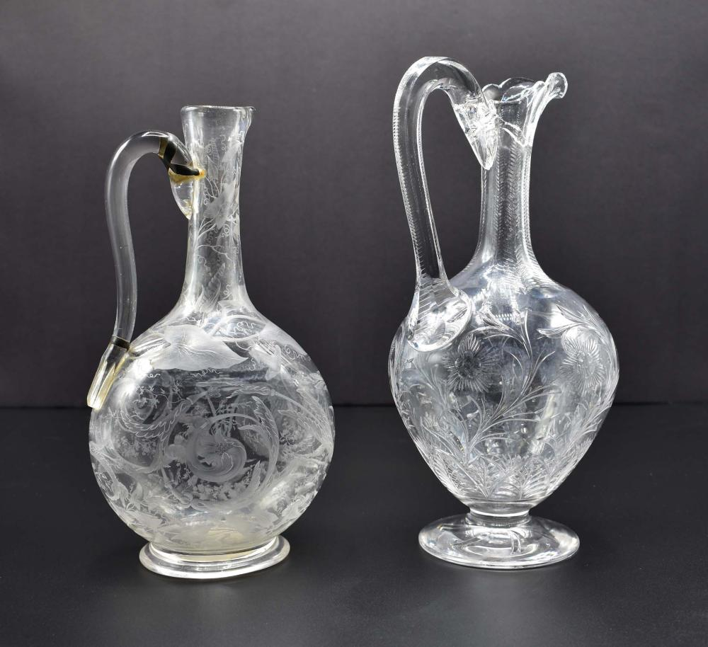 TWO ENGLISH WHEEL-ENGRAVED COLORLESS GLASS EWERS