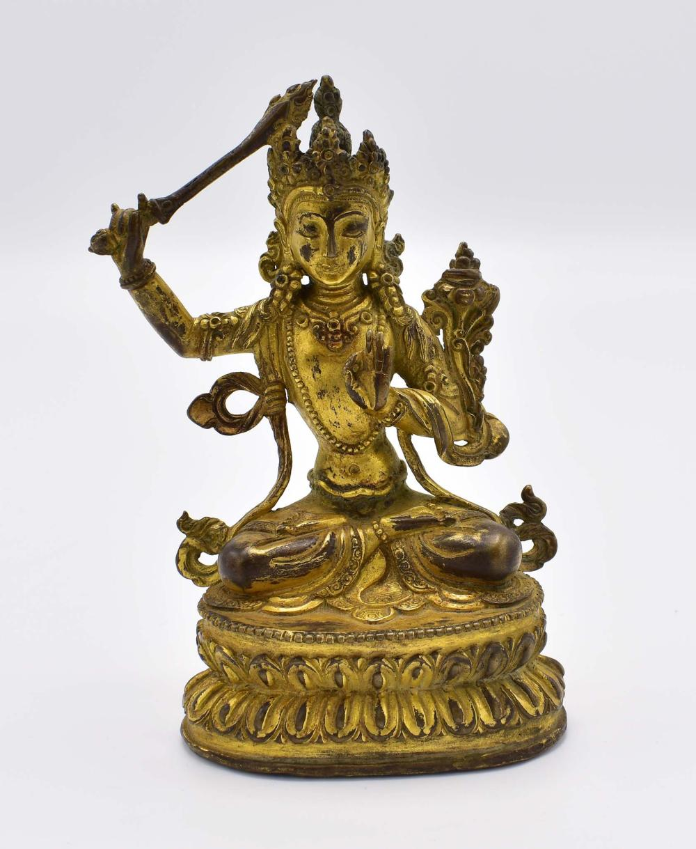 SINO-TIBETAN GILT BRONZE SEATED DEITY