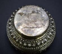 Lot 56: TIBETAN SILVER COVERED CIRCULAR BOX