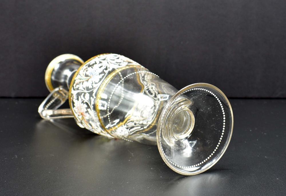 Lot 178: CONTINENTAL PARCEL GILT ENAMEL DECORATED GLASS EWER