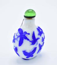 Lot 172: CHINESE BLUE ON WHITE CASED GLASS SNUFF BOTTLE