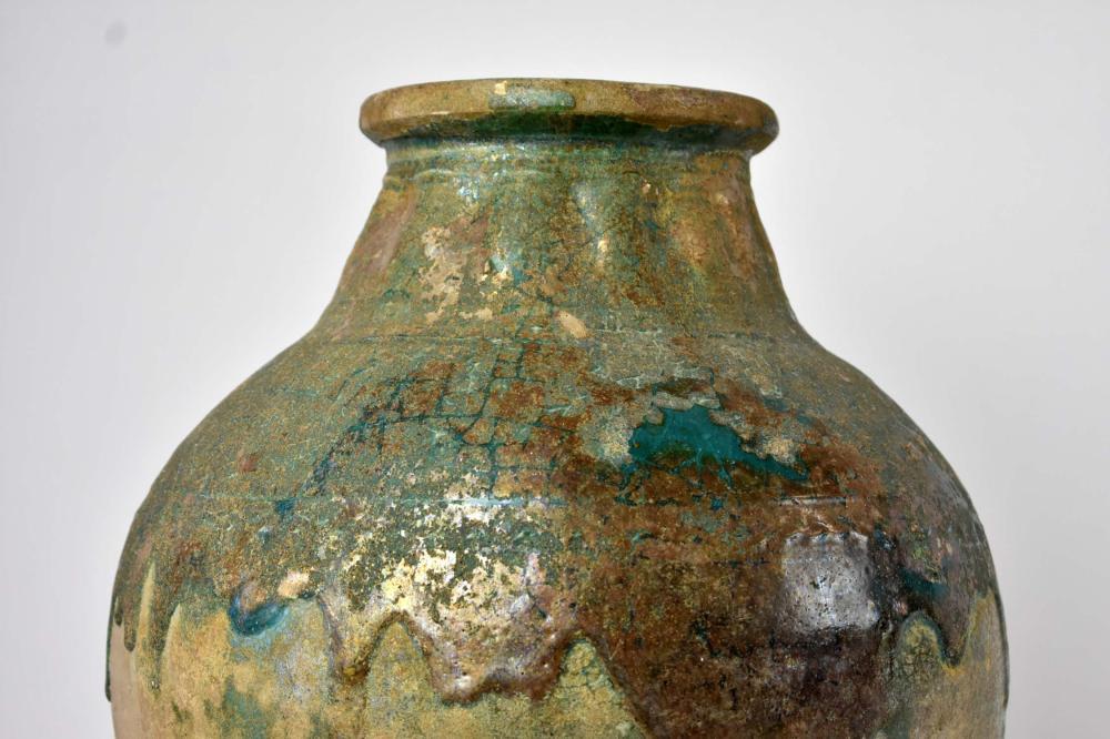 Lot 263: CHINESE GREEN GLAZED EARTHENWARE STORAGE JAR