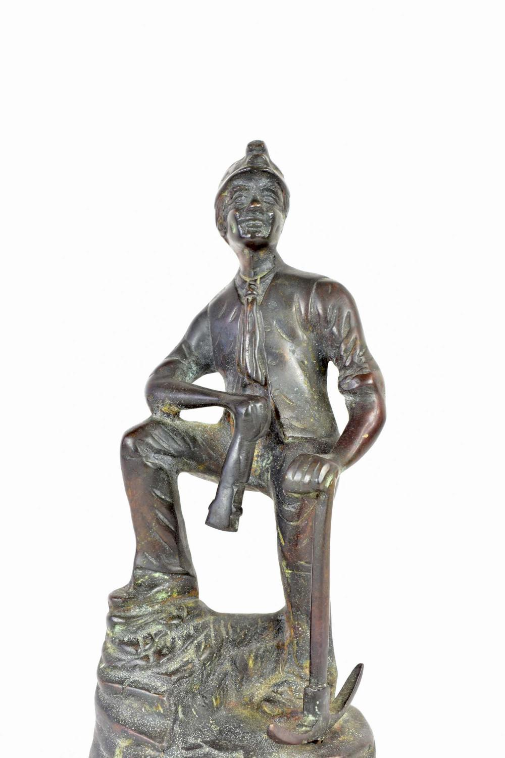 Lot 289: PATINATED BRONZE OF A MINER