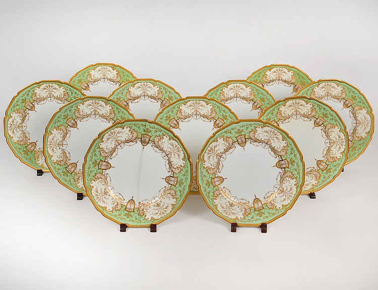 ELEVEN ENGLISH APPLE GREEN & GILT PORCELAIN SERVICE PLATES