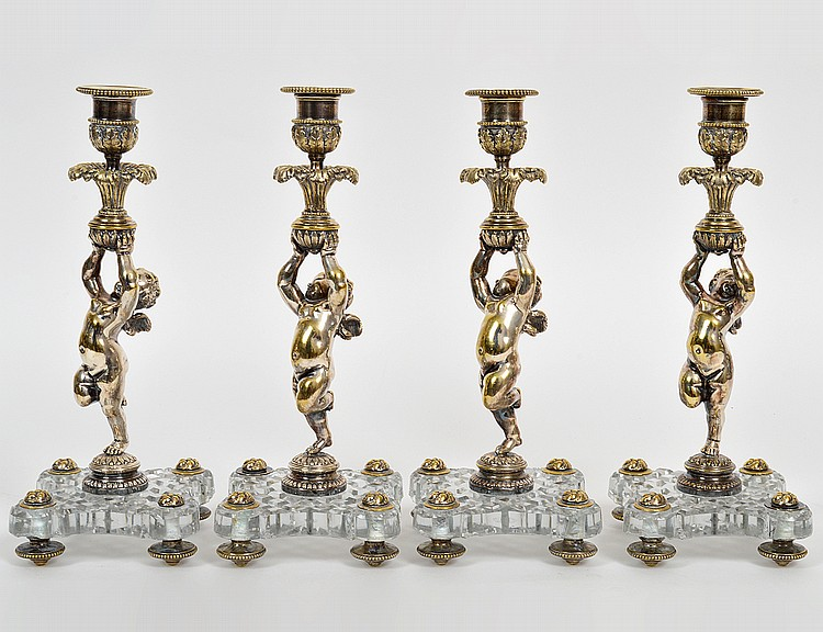 SET OF FOUR SILVERED METAL & CUT GLASS FIGURAL CANDLESTICKS