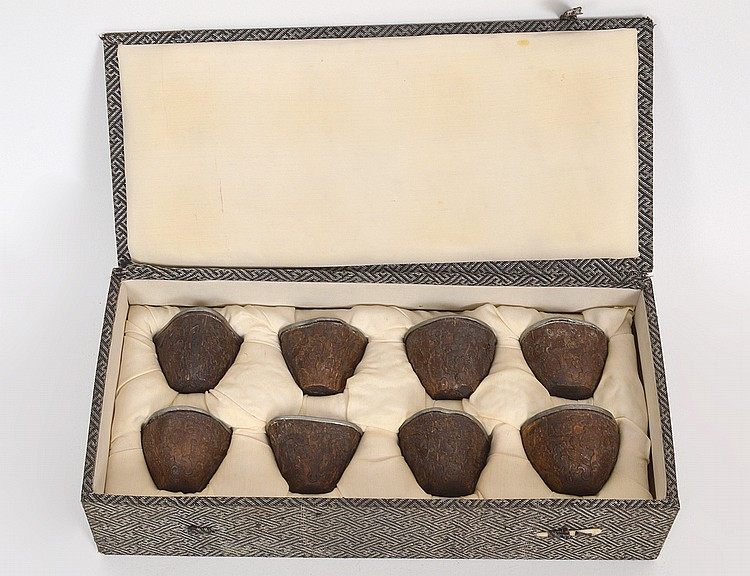 TWELVE CHINESE SMALL PEWTER MOUNTED NUT CUPS