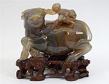 SUPERB CHINESE CARVED AGATE STUDY OF A BOY RIDING A BULL