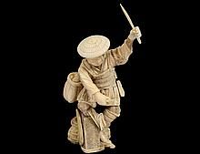 CARVED IVORY FIGURE OF A TRAVELER
