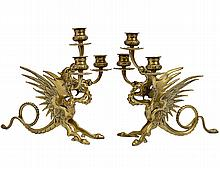 PAIR OF BRASS GRIFFIN THREE LIGHT CANDELABRAS