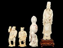 GROUP OF FOUR CARVED IVORY FIGURES