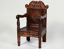 JACOBEAN CARVED OAK CHILD'S CHAIR
