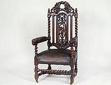 CONTINENTAL BAROQUE STYLE OAK ARMCHAIR