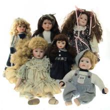 Lot of 6 Porcelain Dolls.