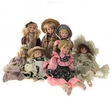 Lot of 7 Porcelain Dolls.