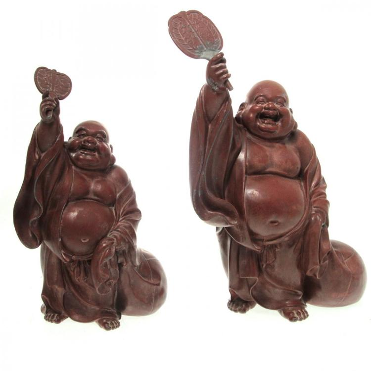 Graduated Pair of Buddha Sculptures.