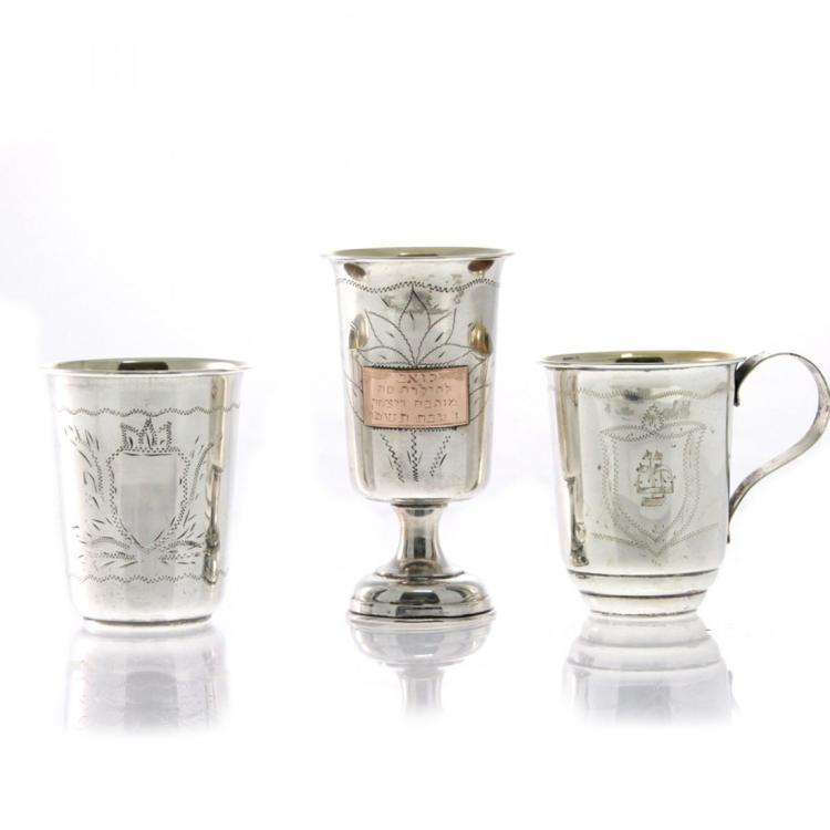 Three Silver Kiddush Cups.