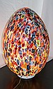 MULTICOLORED MURANO GLASS IN THE FORM OF AN EGG,