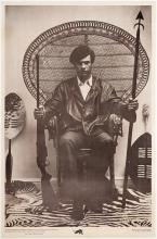 Large poster of Huey P. Newton for the Black Panthers - the famous photograph of him seated in a wicker chair with two weapons