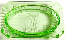 Green glass ashtray with golfer illustration