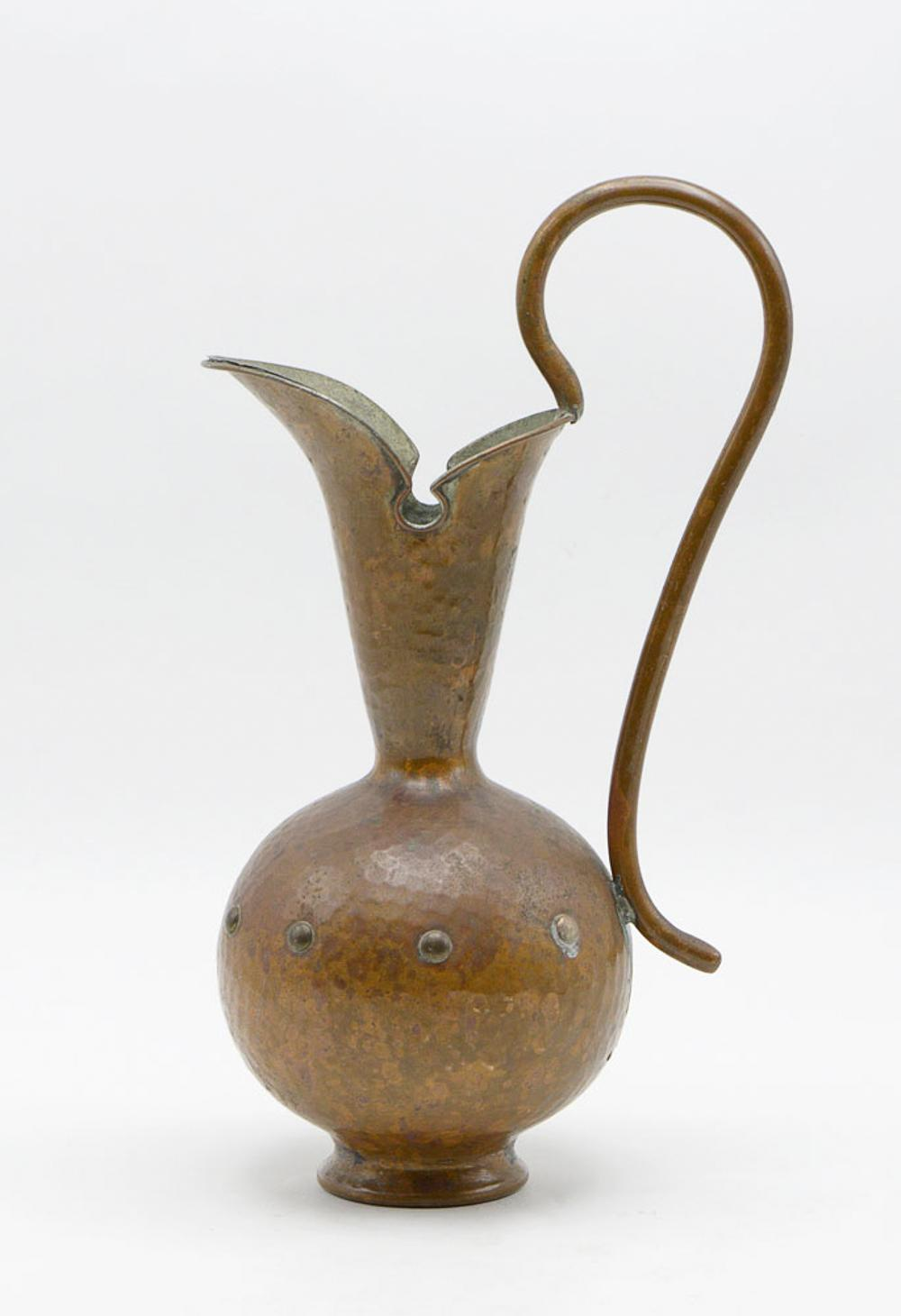 Copper and hammered metal jug