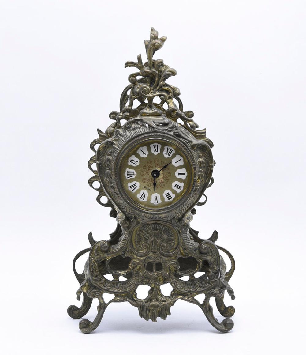Relieved bronze table clock