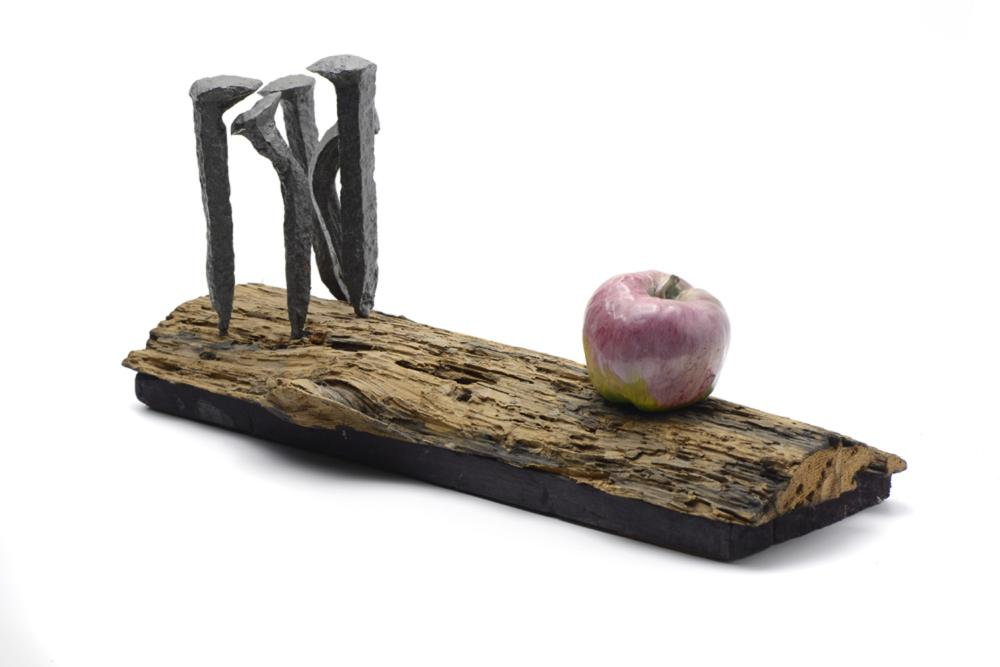 Trunk, nails and apple, iron sculpture, wood