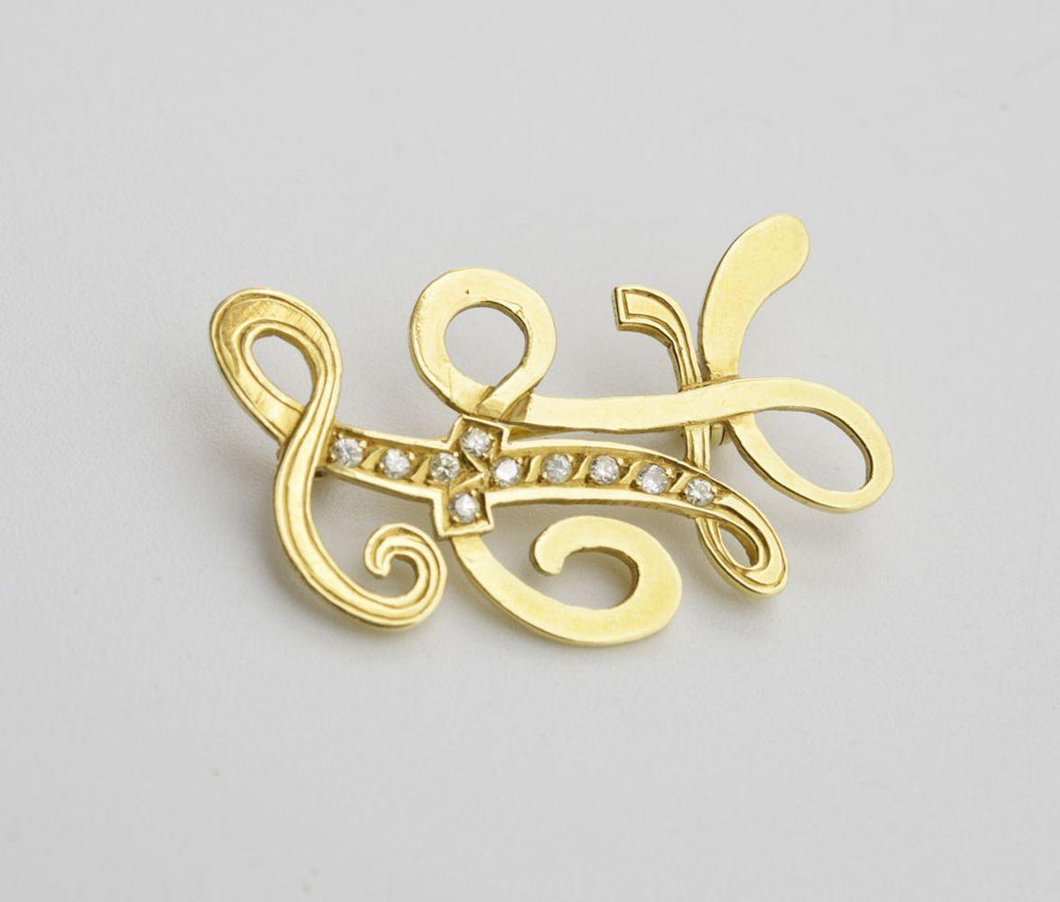 Alfinete em ouro e diamantes, P.: 5,5 g.