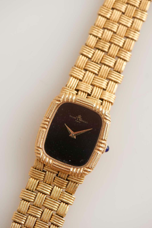 Relógio senhora Baume & Mercier, ouro750% e 800%