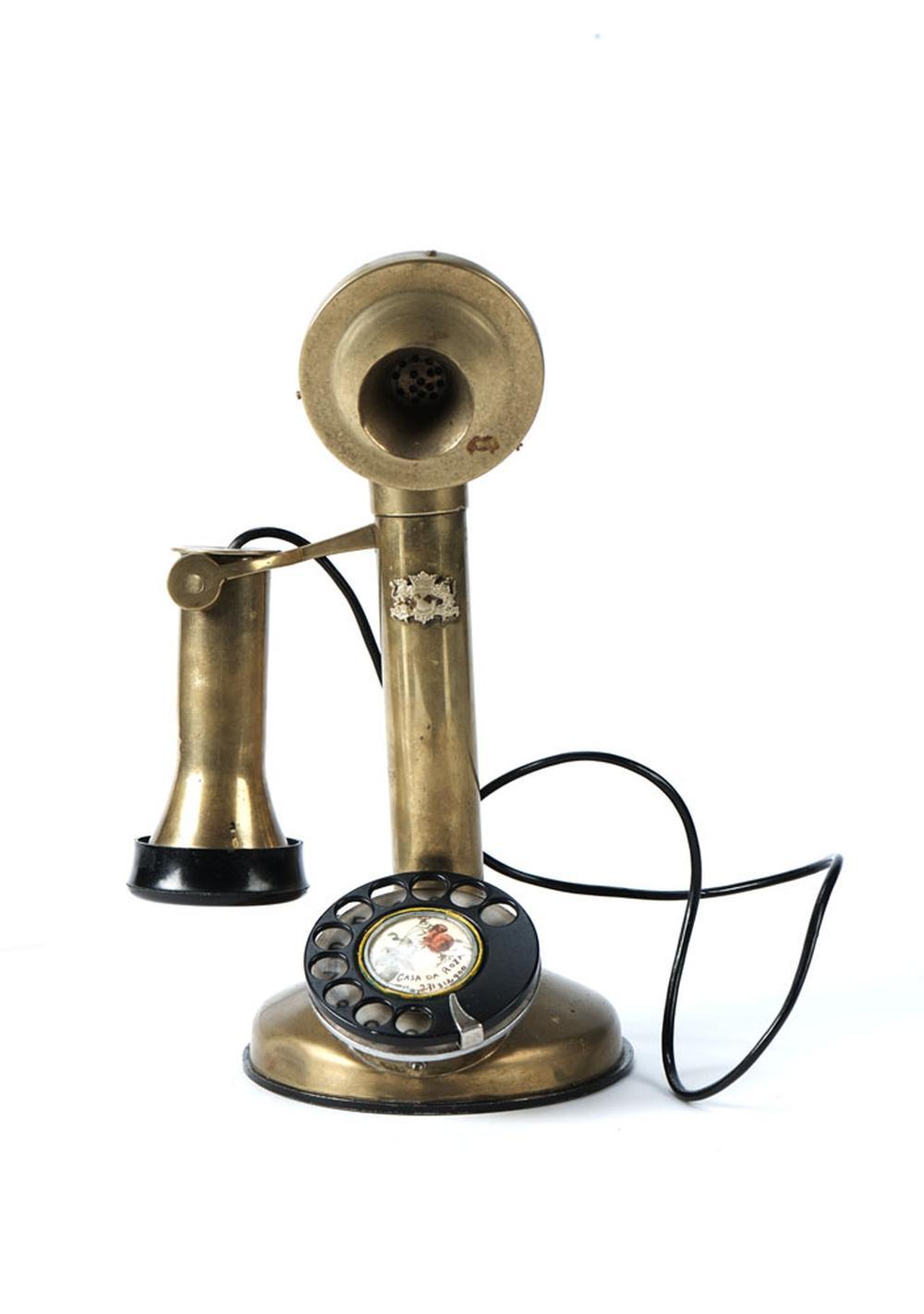 Telefone de mesa em metal e material sintético