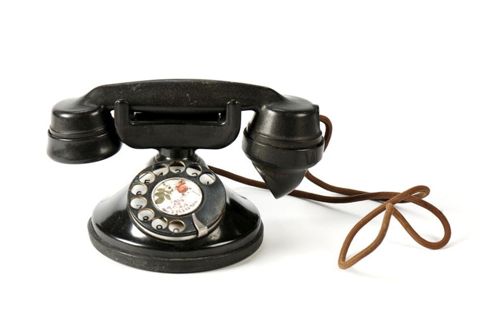 Telefone de mesa em material sintético preto