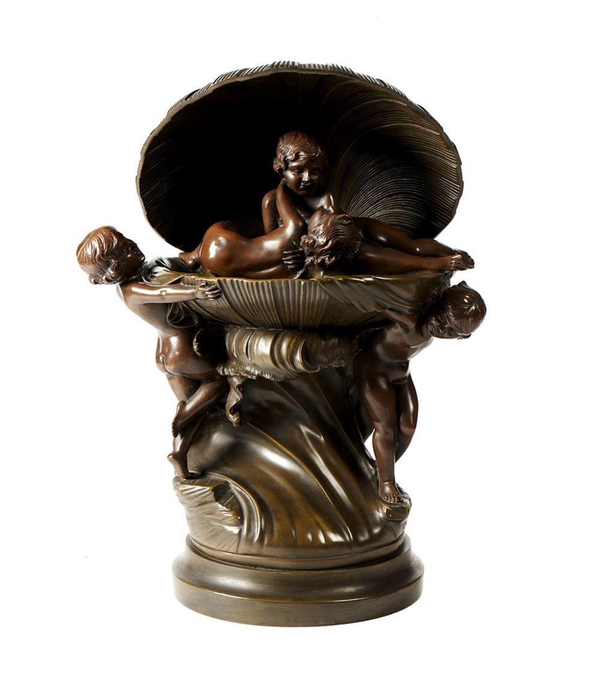 Grupo escultórico, em bronze, representando concha