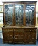A late Victorian walnut library bookcase of