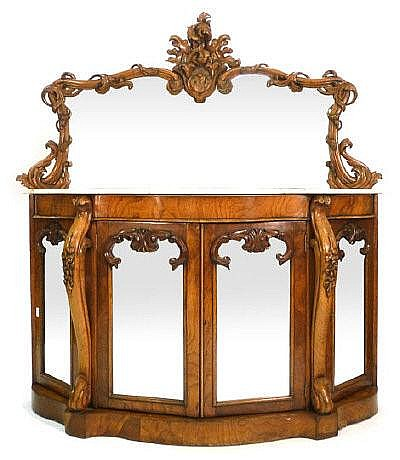 A Victorian figured walnut and richly moulded side