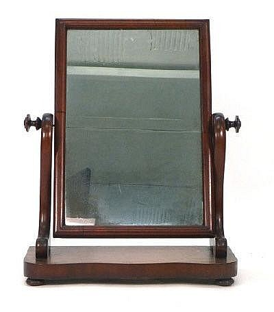 A Victorian mahogany toilet mirror with