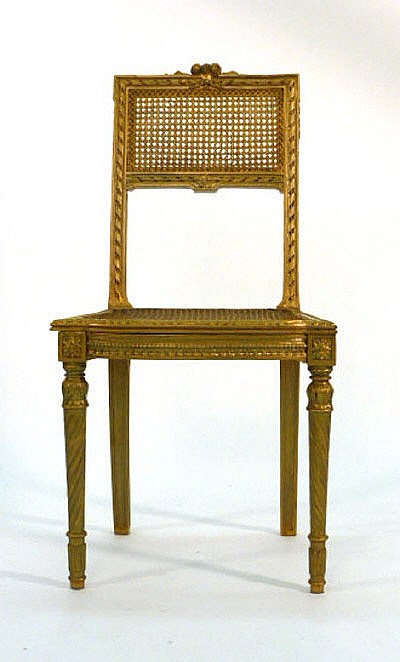 A gilt wood and caned bedroom chair