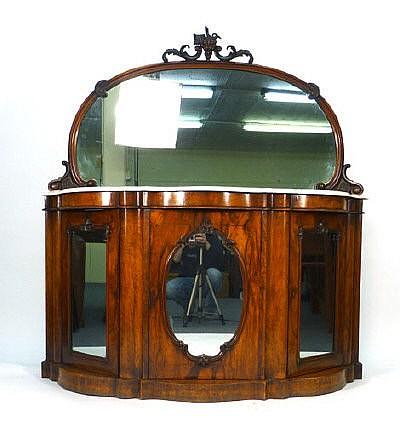 A Victorian rococo-style mirror back chiffonier
