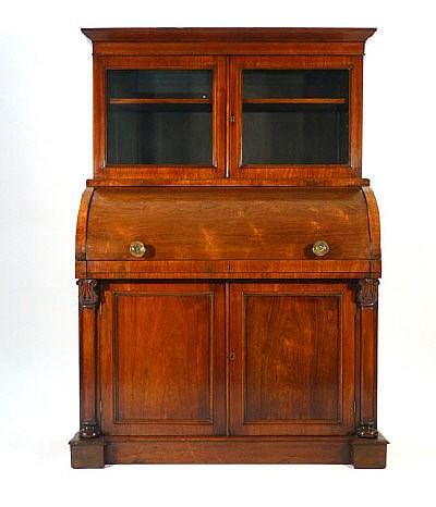 A 19th century rosewood cylinder top bureau