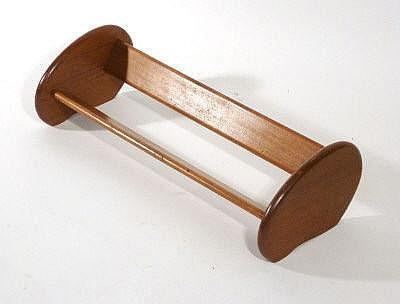 A 1950s teak book trough of typical form, l. 66 cm