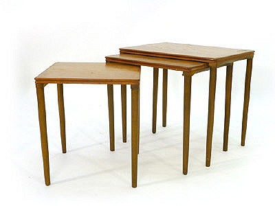 A nest of three Danish teak coffee tables of