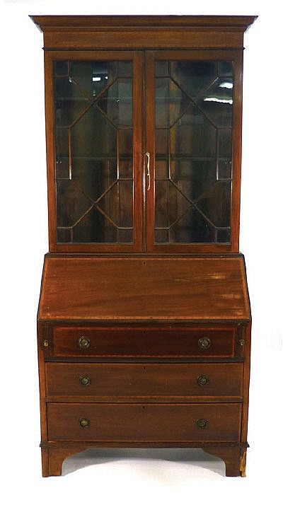 An Edwardian mahogany and crossbanded bureau