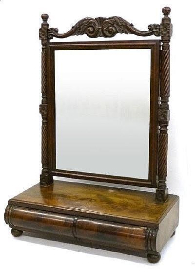 An early 19th century mahogany toilet mirror in