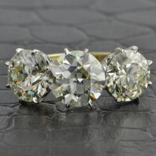 Remarkable Triple Old European Cut Diamond Ring